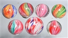 LOT OF 7: ONIONSKIN MARBLES.