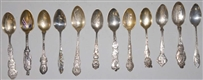 LOT OF 12: STERLING SILVER SOUVENIR SPOONS.