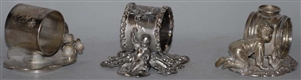 LOT OF 3: FIGURAL NAPKIN RINGS.