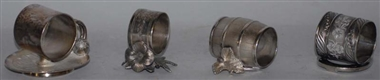 LOT OF 4: FIGURAL NAPKIN RINGS.