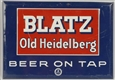 TIN OVER CARDBOARD BLATZ BEER SIGN.