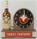 THREE FEATHERS WHISKEY SPINNER CLOCK.