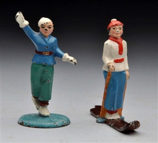 LOT OF 2: CAST IRON SKATER & SKIER PAPERWEIGHTS.