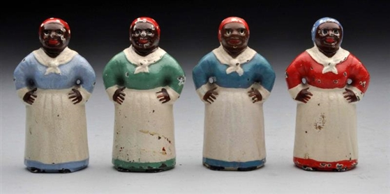 LOT OF 4: CAST IRON ASSORTED MAMMY PAPERWEIGHTS.