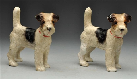 PAIR OF CAST IRON WIREHAIRED FOX TERRIER BOOKENDS.
