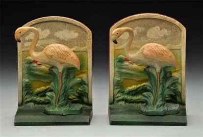 CAST IRON FLAMINGO BOTTLE OPENER BOOKENDS.