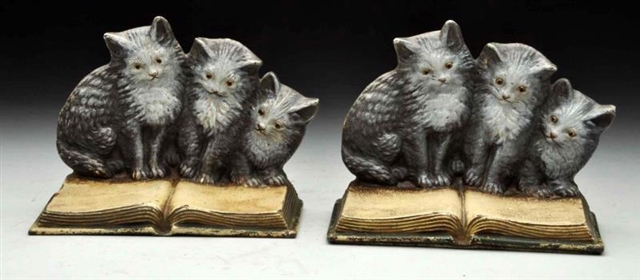 CAST IRON THREE KITTENS ON BOOK BOOKENDS.
