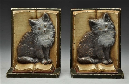 CAST IRON  KITTEN ON BOOK BOOKENDS.