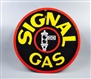 SIGNAL GAS WITH BLACK STOP LIGHT LOGO SIGN.