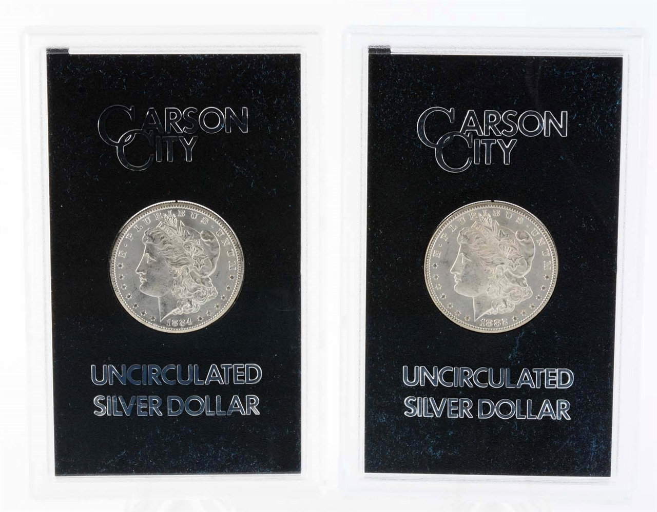 Lot of 2: Carson City Silver Dollars.