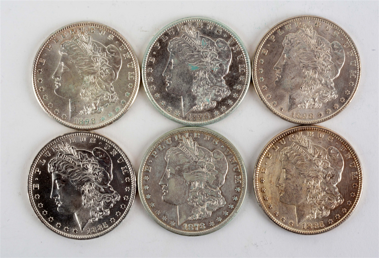 Lot of 6: Morgan Silver Dollars.