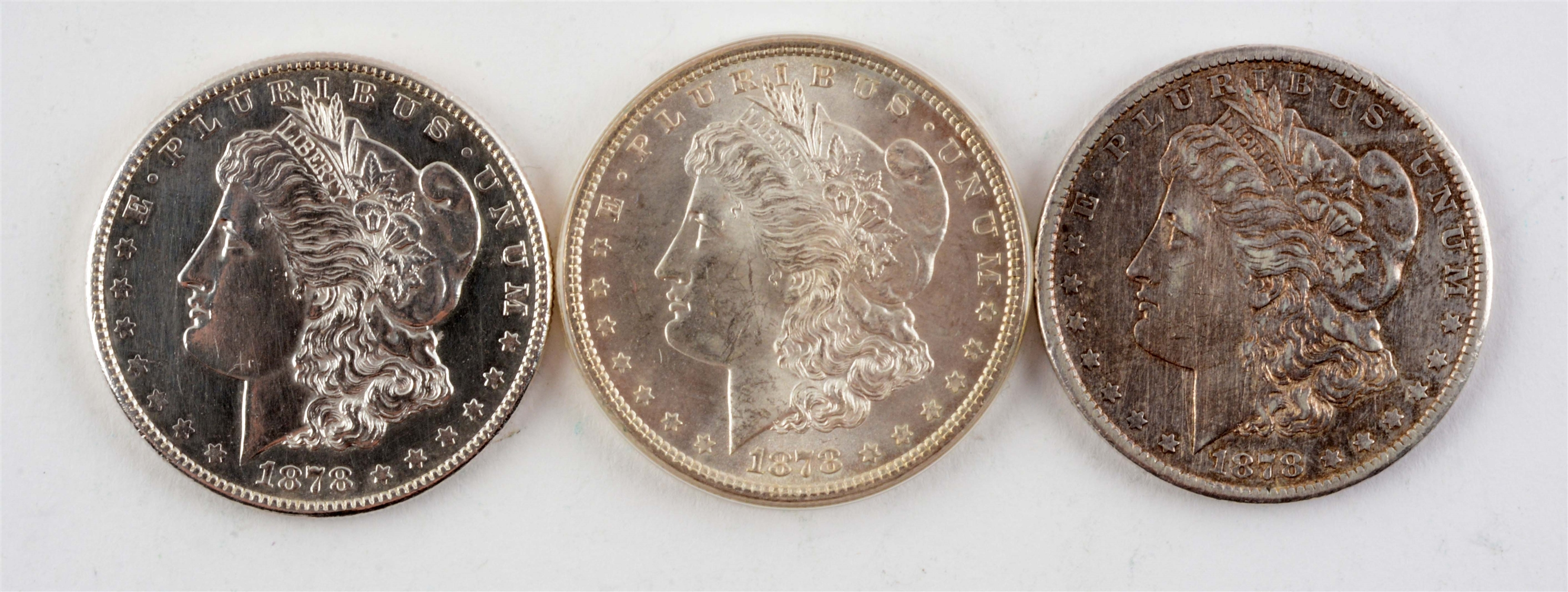 Lot of 3: Morgan Silver Dollars.