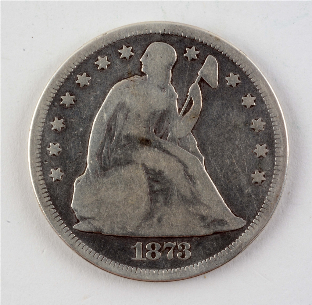 1873 Seated Silver Dollar.