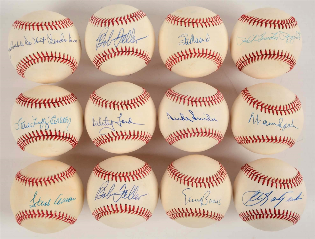 Lot of 12: Single Signed Baseballs Including Hank Aaron.