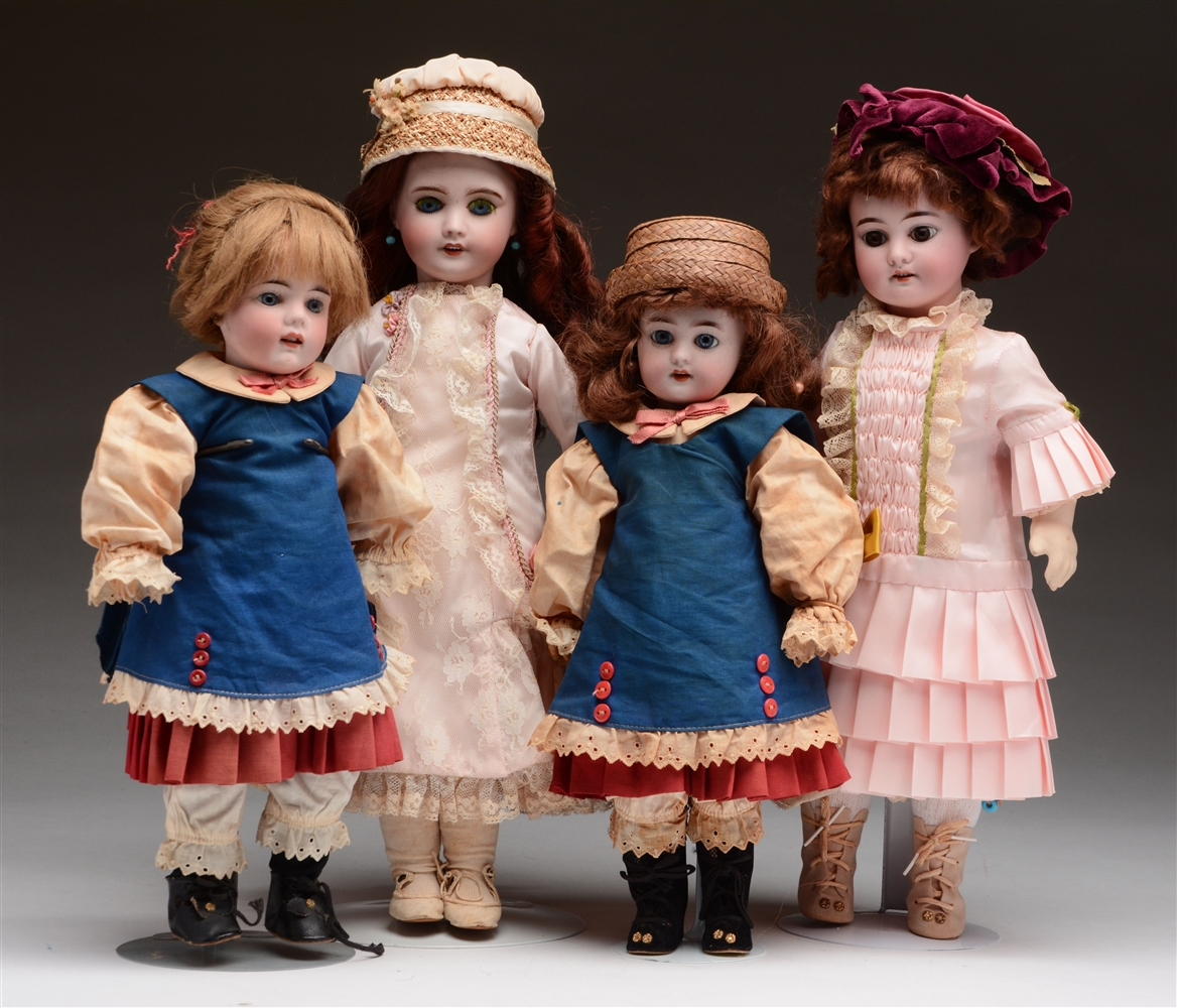Lot of 4: Bisque Head Dolls.