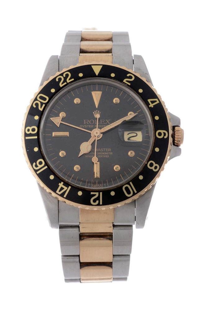 Vintage Rolex 18k Yellow Gold and Stainless Steel GMT-MASTER Wristwatch Model Number 1675.