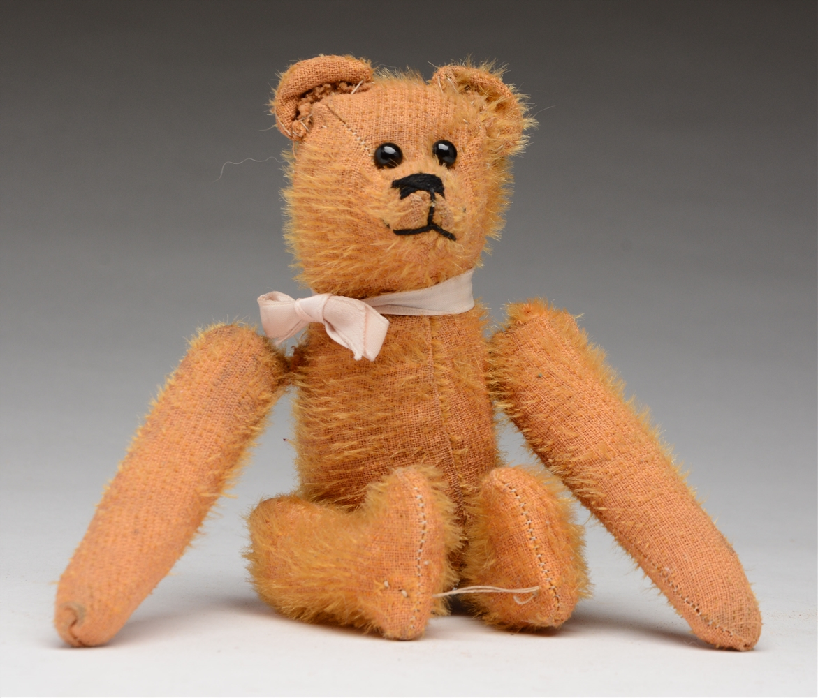 Gold Teddy Bear with Tumbling Action.