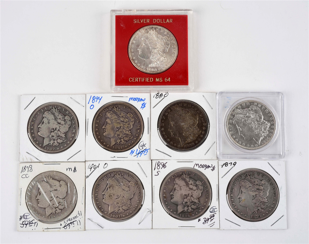 LOT OF 9: MORGAN SILVER DOLLARS.