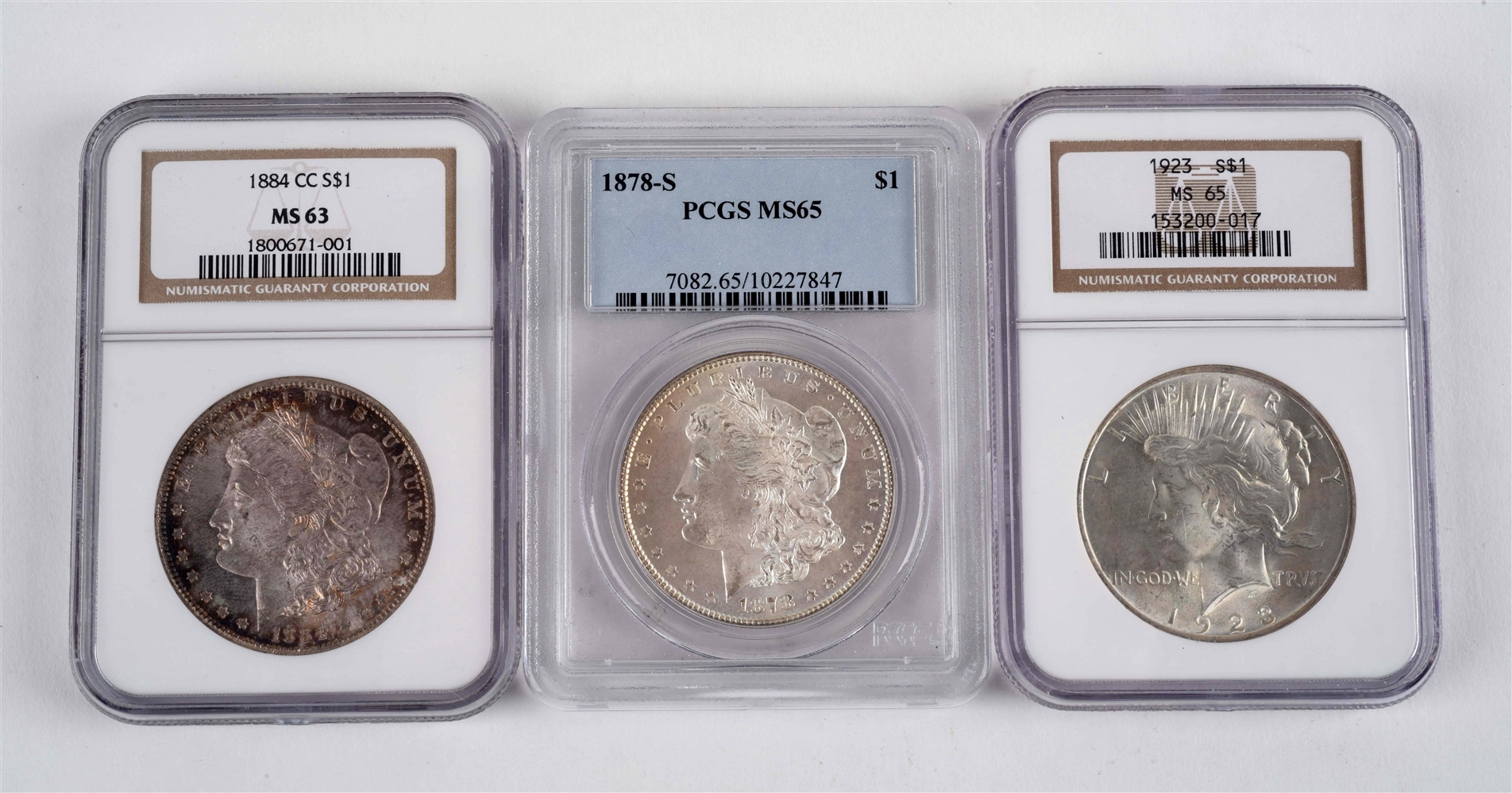 LOT OF 3: GRADED SILVER DOLLARS.
