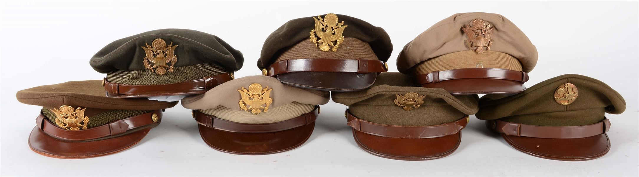 LOT OF 7: WWII US ARMY VISOR CAPS.