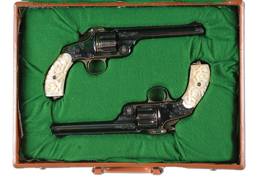 (A) CASED PAIR OF JAPANESE ENGRAVED SMITH & WESSON NO. 3 REVOLVERS WITH CARVED PEARL GRIPS.