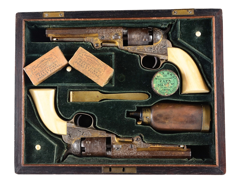 (A) CASED PAIR OF ENGRAVED COLT 1849 POCKET REVOLVERS PRESENTED TO ADMIRAL JAUN WILLIAMS.