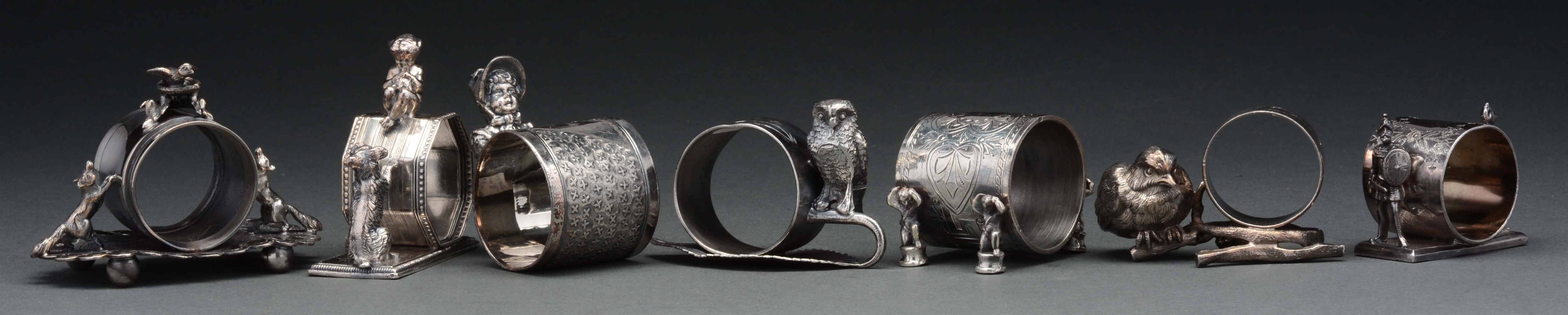 Lot Of 7: Figural Napkin Rings.