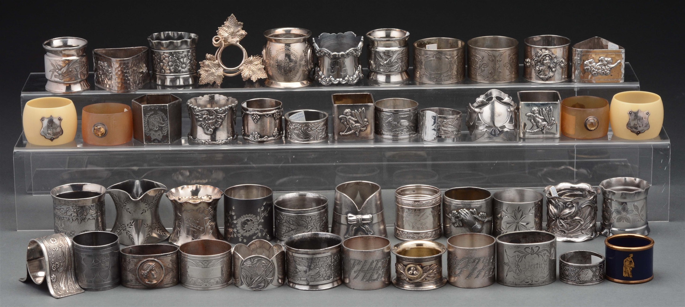 Lot Of Over 50 Silver Plated Antique Napkin Rings.