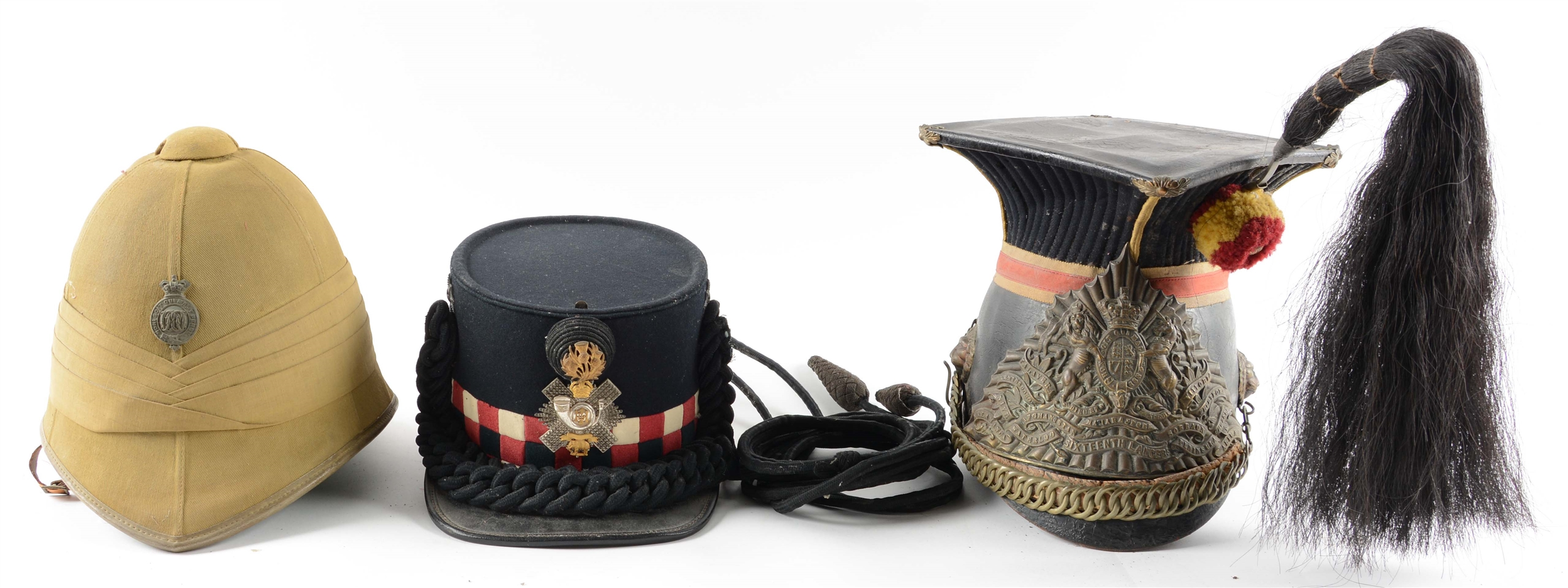 Lot of 3: British 16th Lancer Helmet, Highland Light Infantry Shako & Sun Helmet.