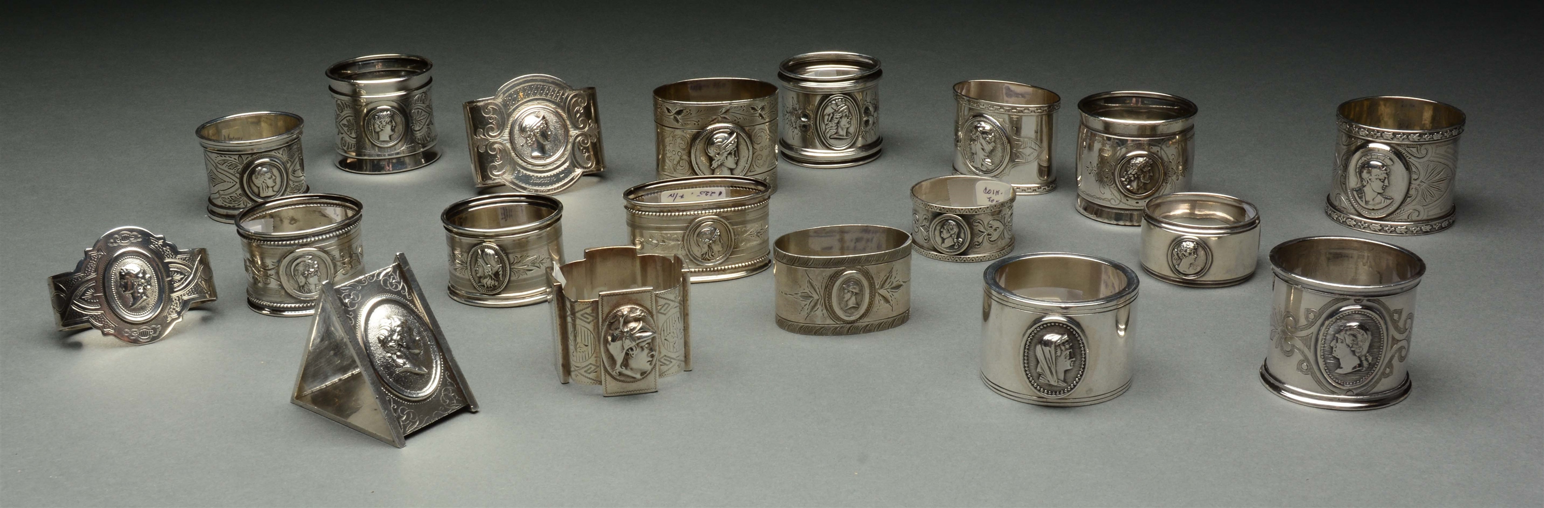 Lot of 20: Coin Medallion Silver Napkin Rings.