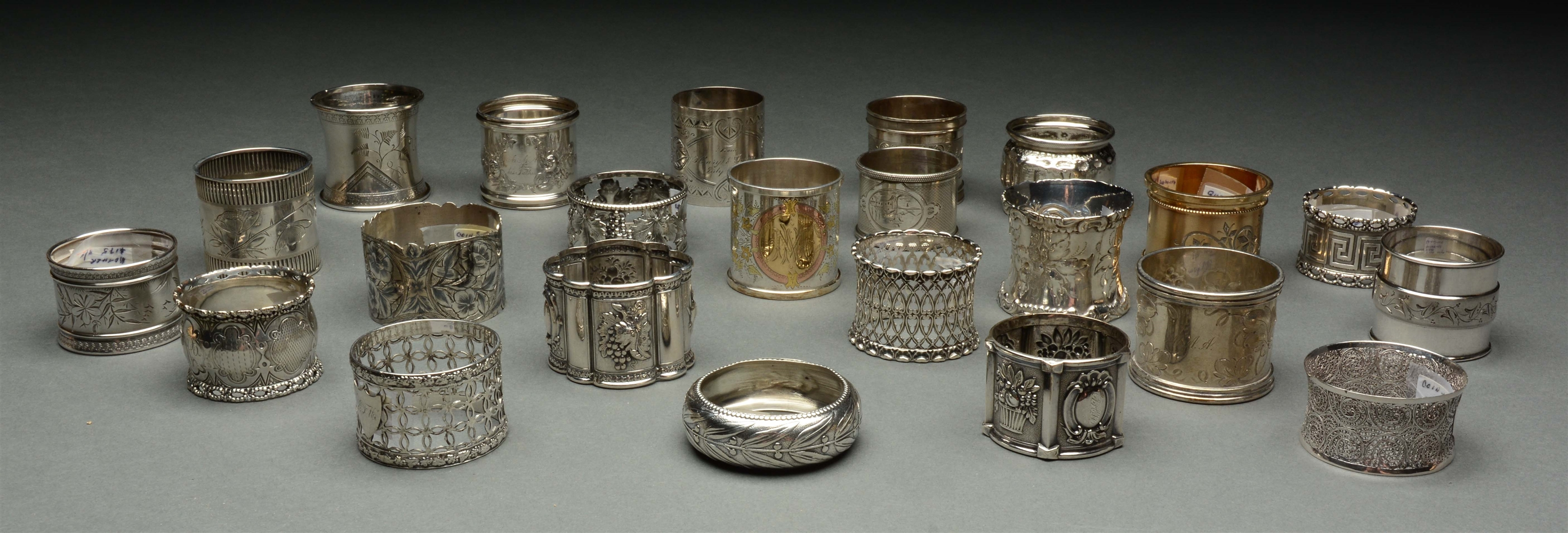 Lot Of 23: Coin Silver Napkin Rings.