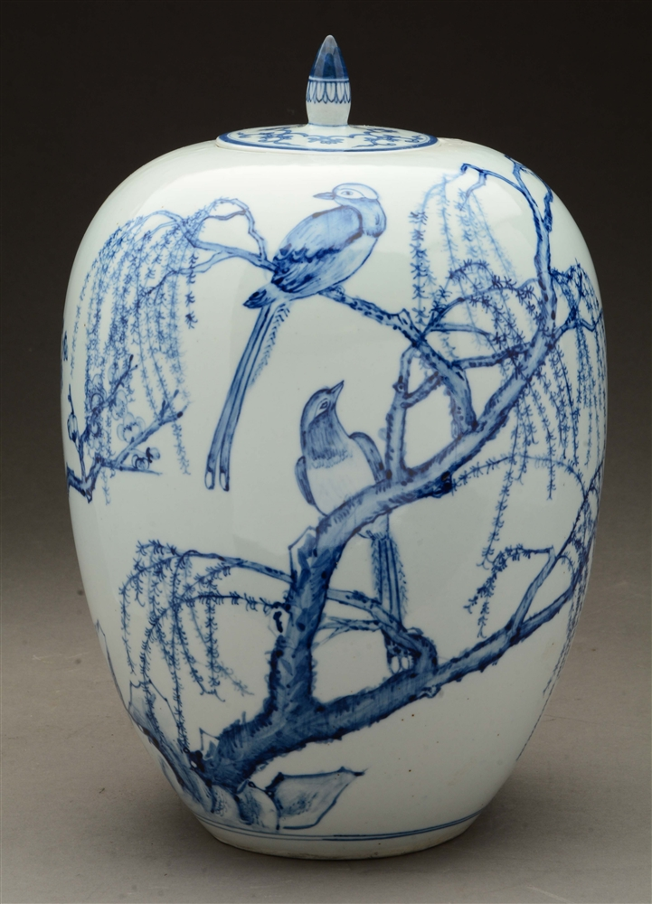 Chinese Covered Urn Decorated with Fanciful Birds and Flowering Trees in Underglaze Blue.