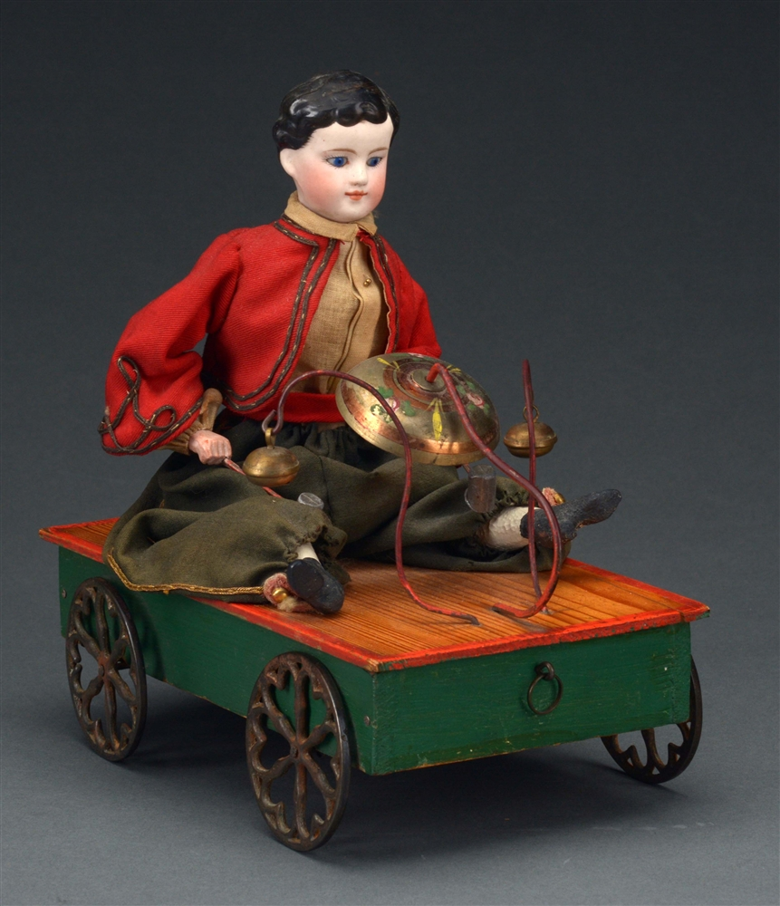 Seated Child on Wheeled Platform Bell Toy.