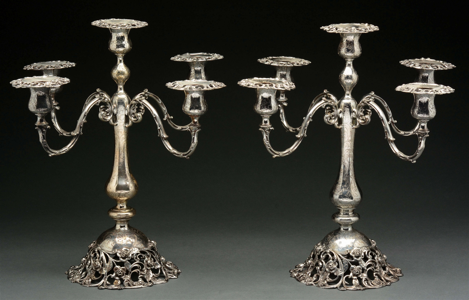 A Pair of American Sterling Five-Light Candelabra.