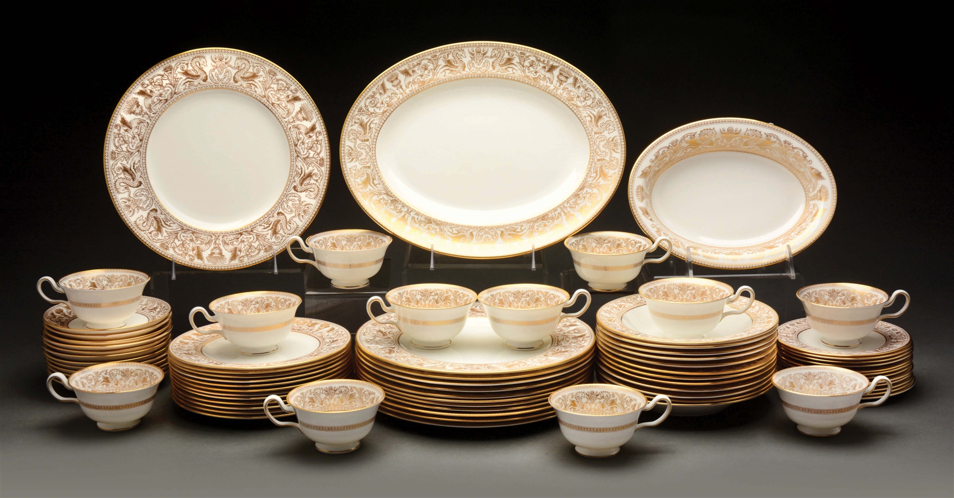 "Wedgwood Dinner Service for 12 in ""Gold Florentine"" Pattern."