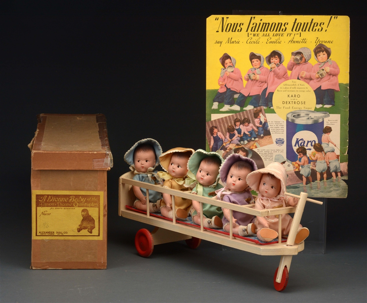 DIONNE QUINTUPLETS IN CART WITH ORIGINAL BOX.