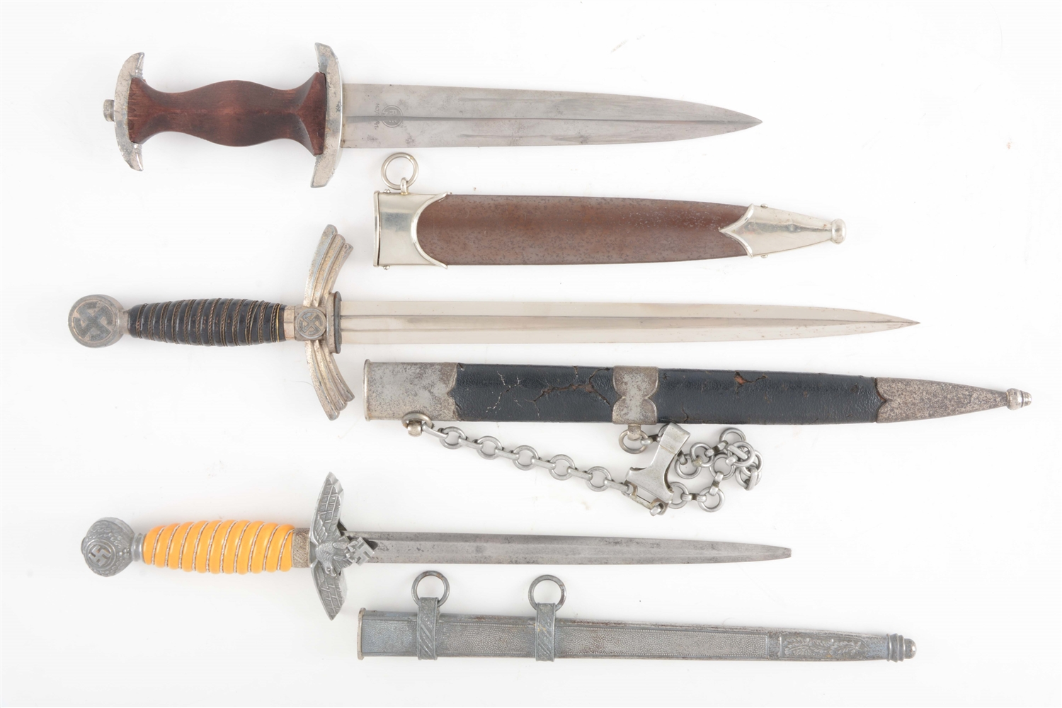 LOT OF 3: THIRD REICH SA, LUFTWAFFE FIRST MODEL, AND LUFTWAFFE DAGGERS.