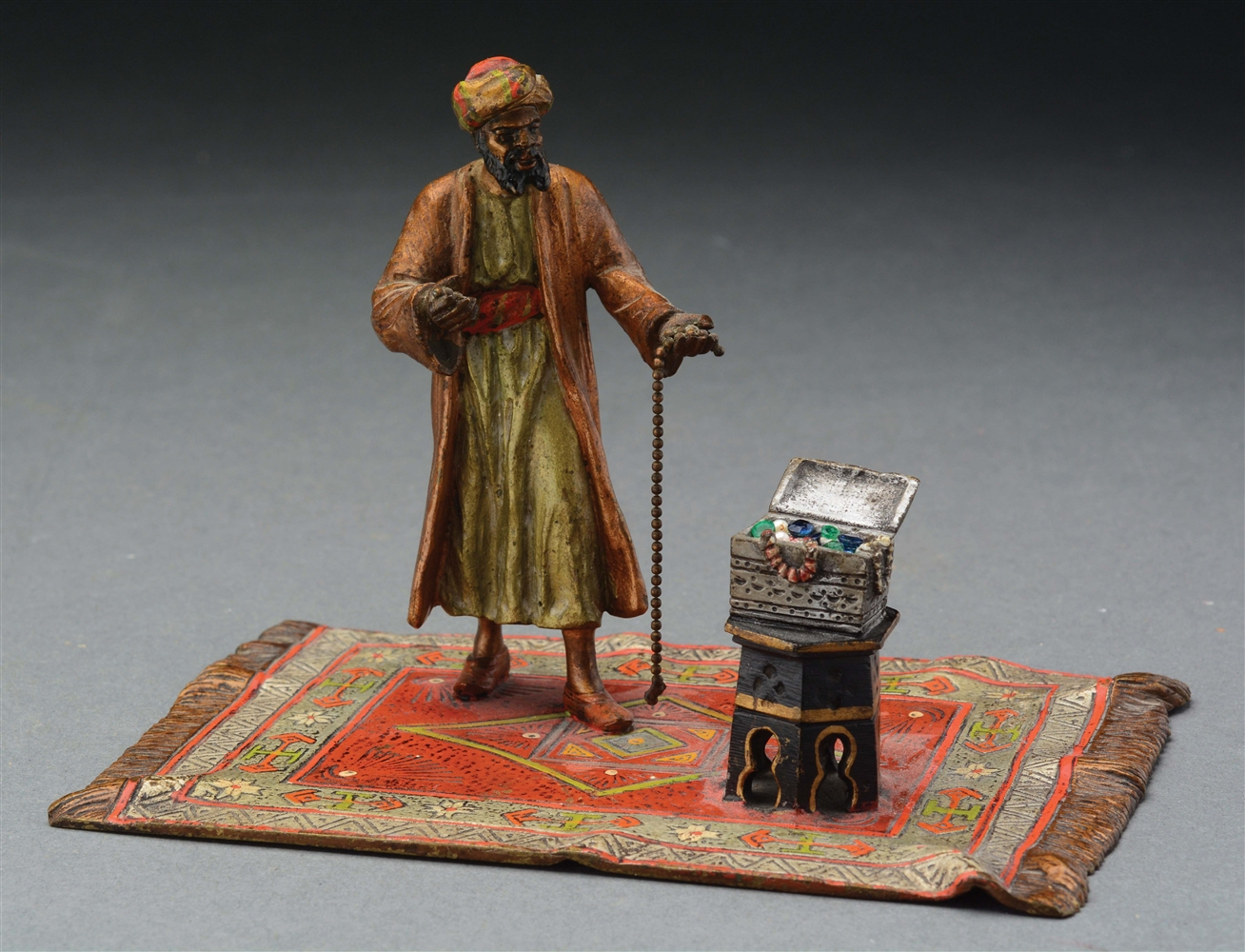 Austrian Bronze Figure of Man on Carpet with Box and Jewels.