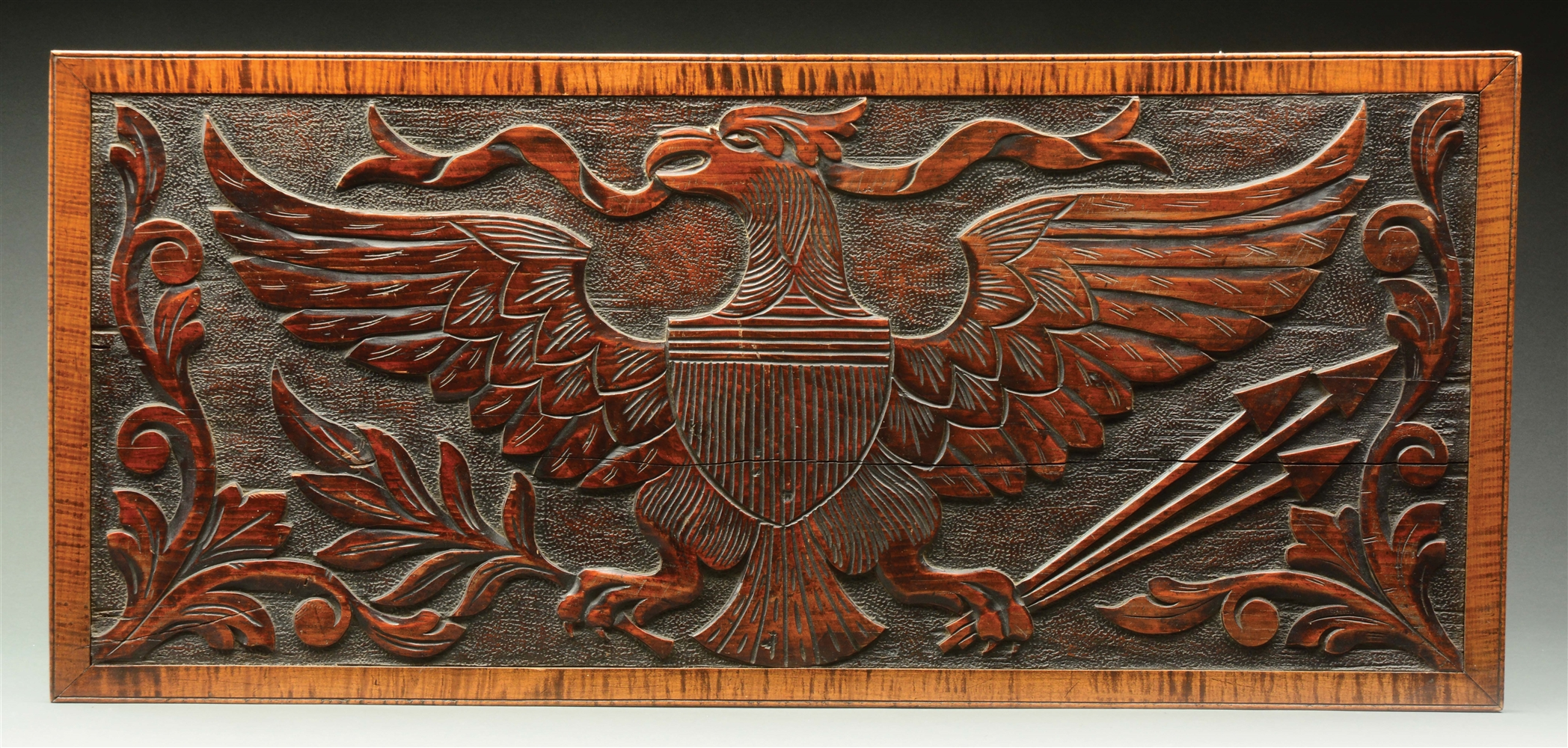 CARVED FEDERAL AMERICAN EAGLE PLAQUE WITH TIGER MAPLE FRAME.