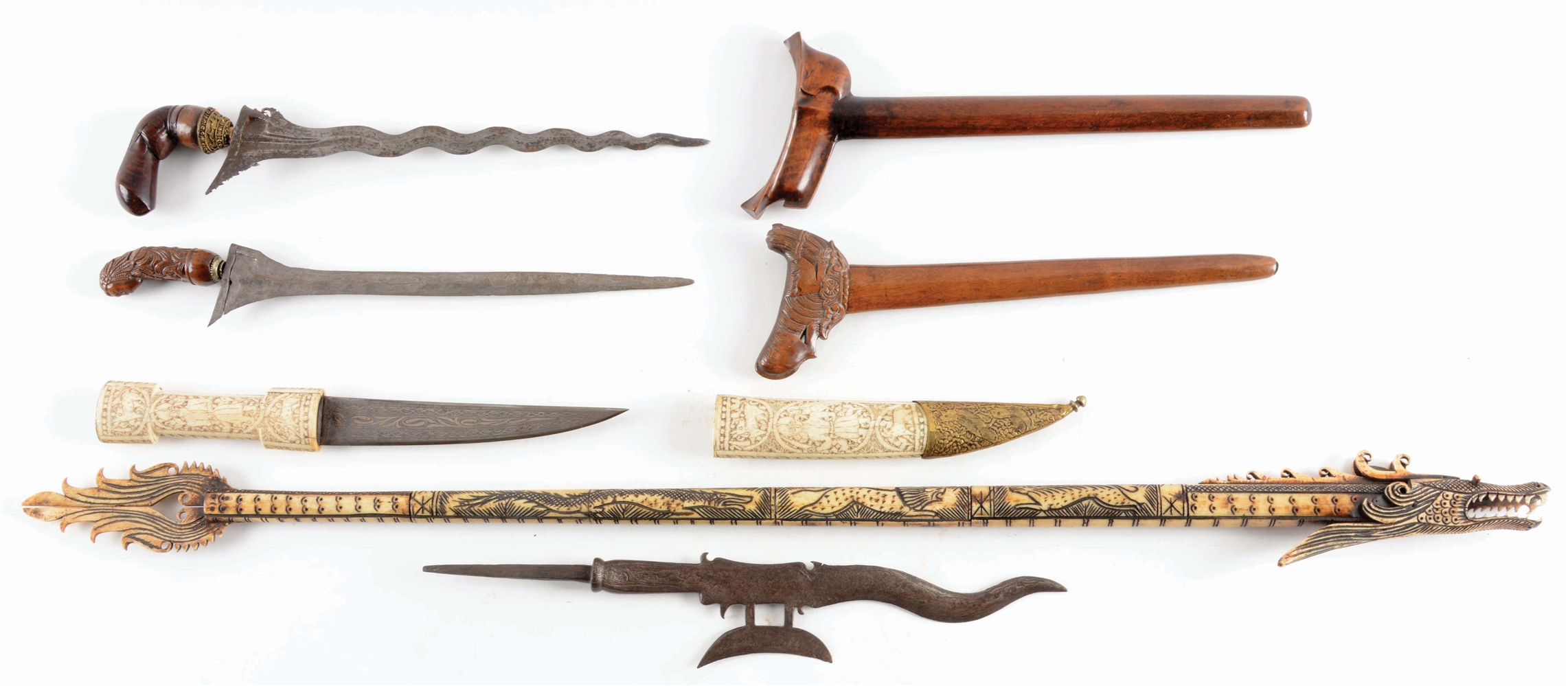 Lot of 5: An Interesting Lot of Five Ethnic Weapons, Including Two Indonesian Krisses, A Bone Mounted Ottoman Kanhanjar, a Dragon Blowgun, and an Indonesian Halberd.