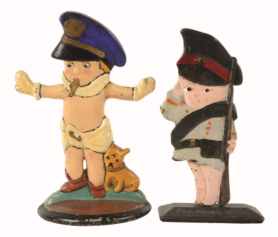 LOT OF 2: CAST-IRON POLICE BOY & MILITARY BOY DOORSTOPS.