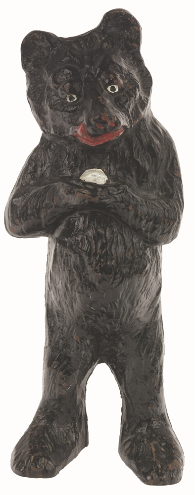 CAST-IRON STANDING HONEY BEAR DOORSTOP.