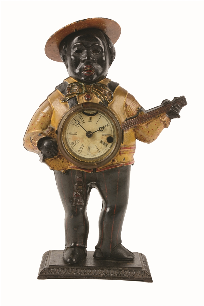 CAST-IRON BLACK AMERICANA MUSICIAN SAMBO BANJO PLAYER BLINKING-EYE CLOCK.