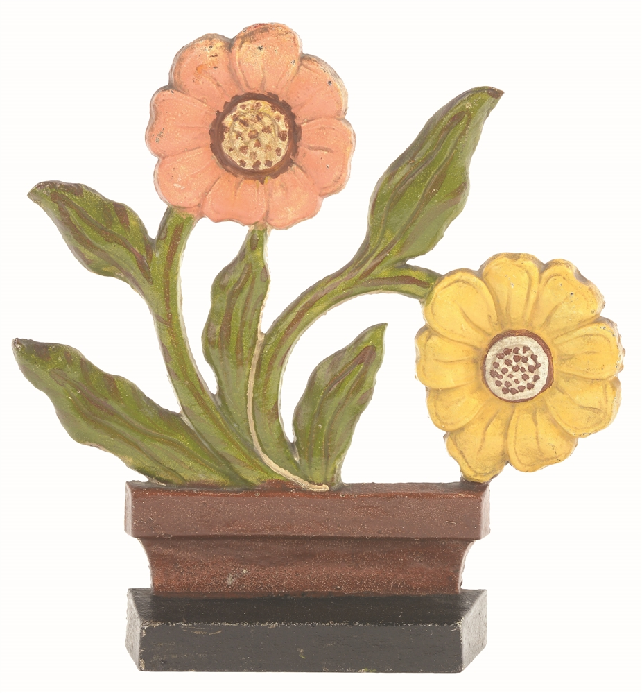 CAST-IRON MODERNISTIC FLOWER DOORSTOP.