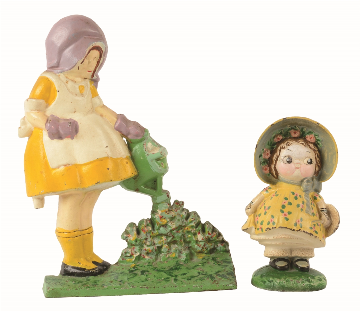 LOT OF 2: CAST-IRON DOLLY & MARY QUITE CONTRARY DOORSTOPS.