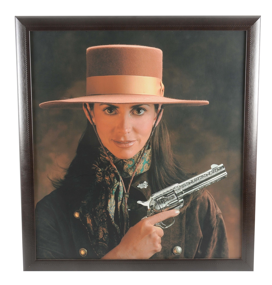 FRAMED PICTURE OF 2001 AMERICAN WESTERN ARMS WORLD CHAMPION ANNIE ELLETT.