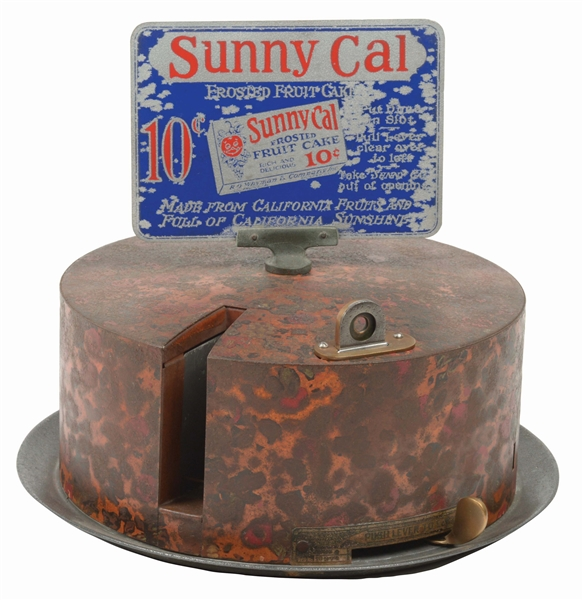 10¢ SUNNY CAL FROSTED FRUIT CAKE VENDING MACHINE.