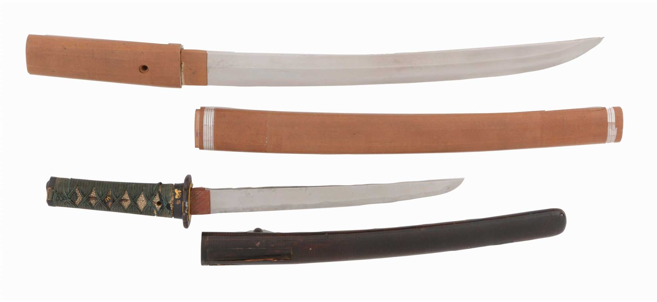 LOT OF TWO: ONE WAKIZASHI AND ONE TANTO, ONE KOTO AND THE OTHER SHIN-SHINTO, ONE IN SHIRASAYA AND ONE IN KOSHIRAE.