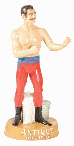 "FIGURAL BOXER ""ANTIQUE BOURBON"" ADVERTISING FIGURE."