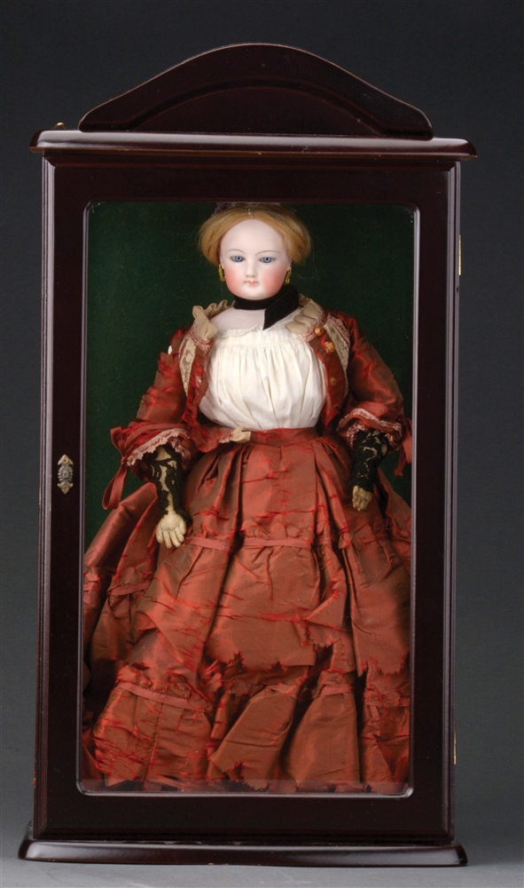 FRENCH FASHION DOLL IN WOODEN GLASS-FRONTED DISPLAY CASE.